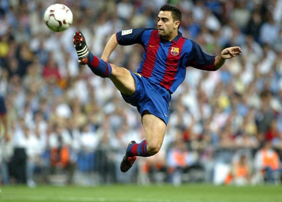 See how he maintains control of the ball in the mid air - Xavi.